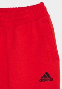 adidas Performance - STRIPES ATHLETICS SPORTS REGULAR PANTS UNISEX - Pantalones deportivos - hirere/black - 2