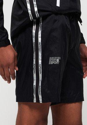 ACTIVE TRAINING  - Sports shorts - black
