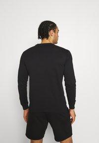 Champion - CREWNECK LONG SLEEVE  - Long sleeved top - black - 2