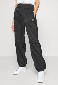 adidas Originals - BELLISTA NYLON CUFFED SPORT PANTS - Verryttelyhousut - black - 0