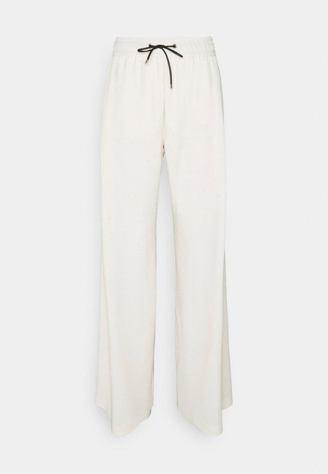 Pantalones - cashew