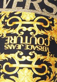 Versace Jeans Couture - LADY FUSEAUX - Legging - black - 6