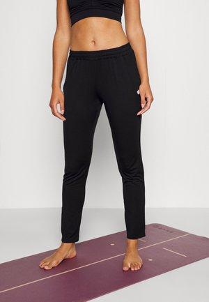 SATIA - Pantalon de survêtement - black