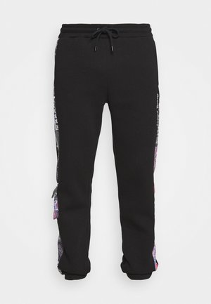 CARTEL JOGGER - Tracksuit bottoms - black/multi