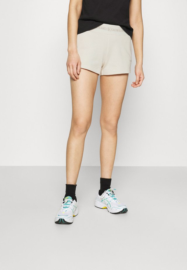LOGO TRIM - Pantaloni sportivi - white sand