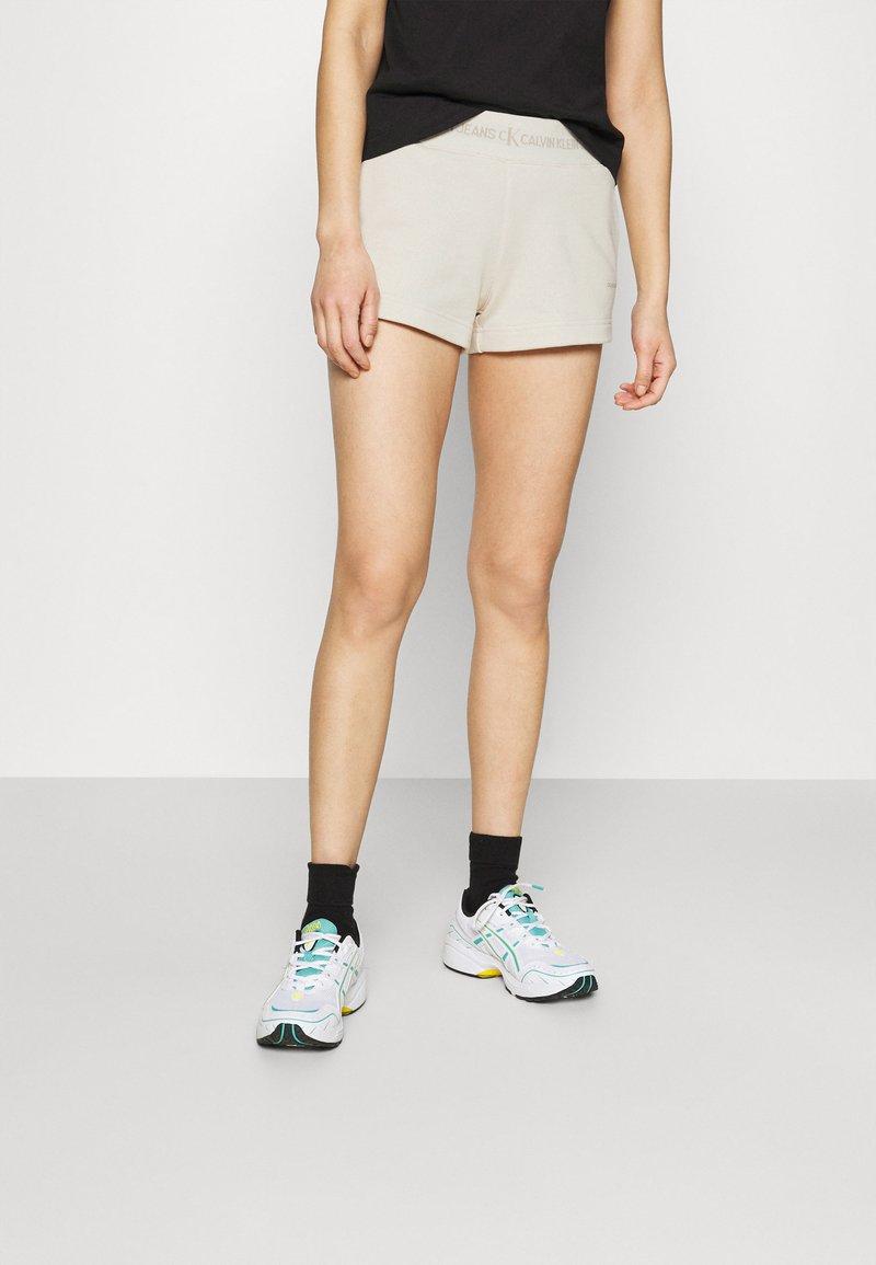 Calvin Klein Jeans - LOGO TRIM - Tracksuit bottoms - white sand