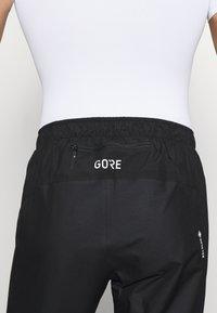 Gore Wear - GORE® C3 GORE-TEX PACLITE® - Trousers - black - 5