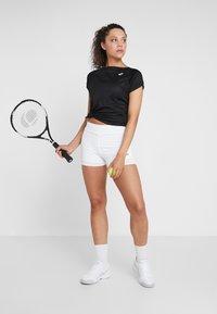 Mizuno - FLEX SHORTS - Sports shorts - white - 1