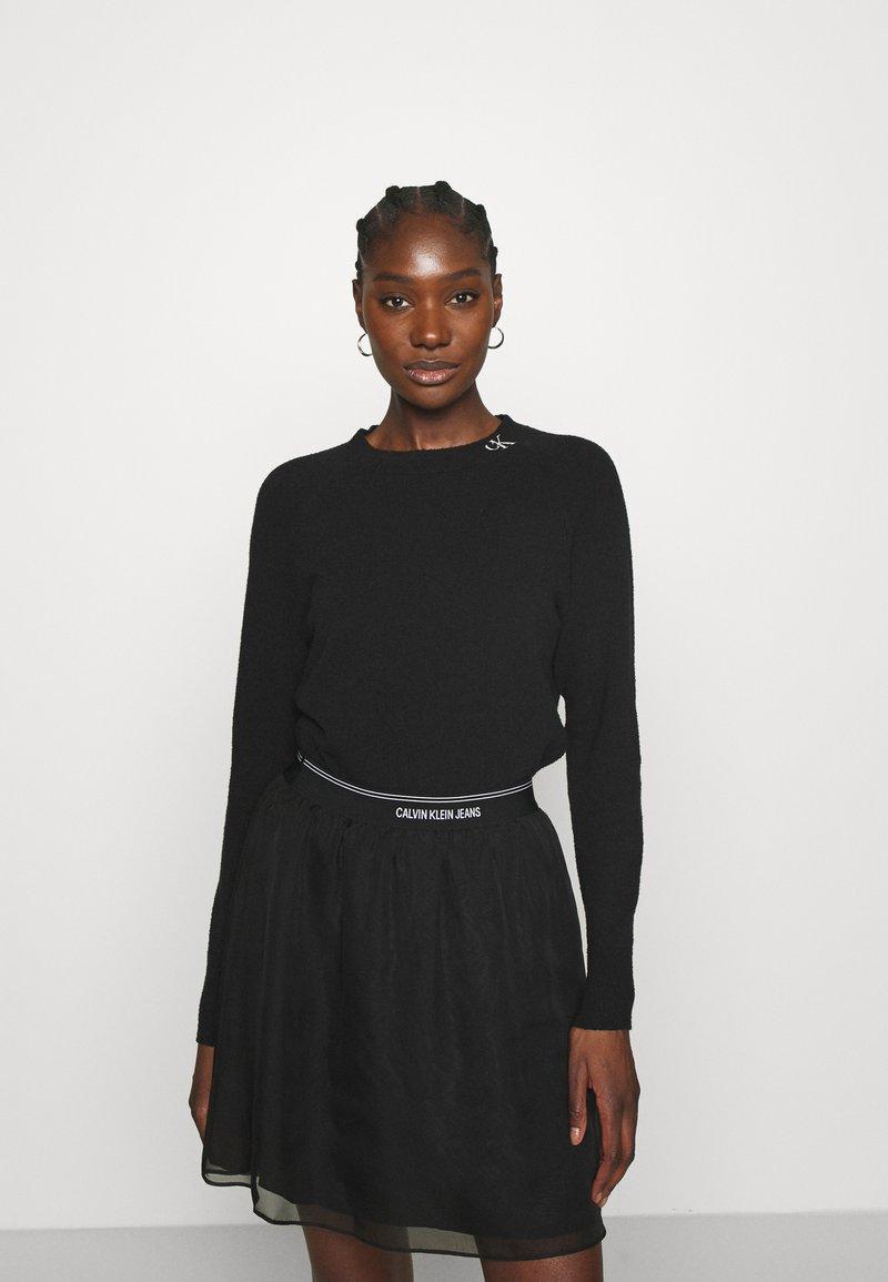 Calvin Klein Jeans - NECK LOGO FLUFFY SWEATER - Jumper - black