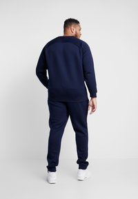Urban Classics - CUT AND SEW PLUS SIZE - Tracksuit bottoms - midnightnavy - 2