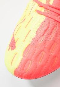 Puma - FUTURE 5.1 NETFIT OSG FG/AG - Moulded stud football boots - energy peach/fizzy yellow - 6