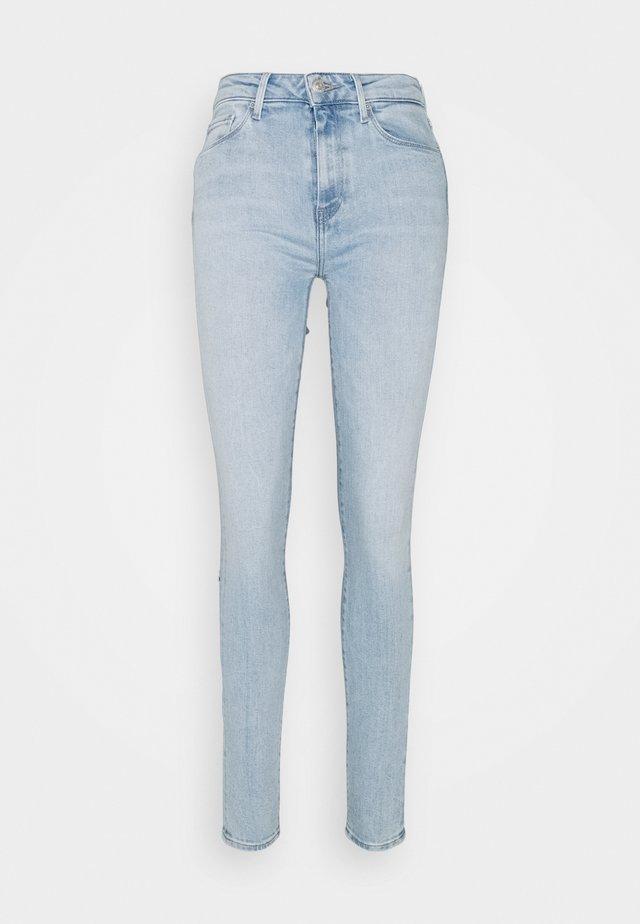 Skinny džíny - bleached denim