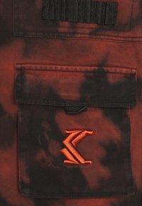 Karl Kani - BLEACHER UTILITY VEST - Smanicato - black - 2