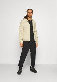 adidas Performance - VARILITE SOFT HOODED - Down jacket - savann - 1