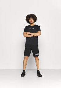 Calvin Klein Performance - SHORTS - Pantaloncini sportivi - black - 1