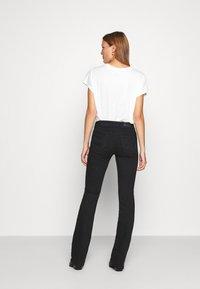 LTB - ROXY - Flared Jeans - black to black - 2