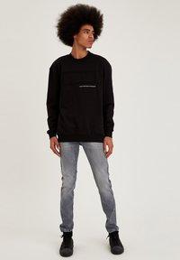 DeFacto - OVERSIZED - Sweatshirt - black - 1
