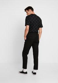 Calvin Klein Tailored - PINSTRIPE TROUSER CASUAL - Trousers - black - 2