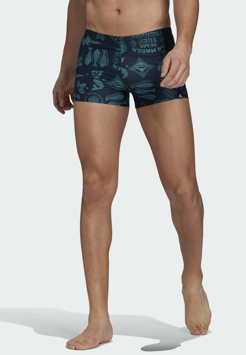 adidas Performance - FESTIWILD - Swimming trunks - blue