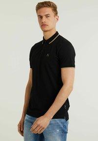 CHASIN' - Polo shirt - black - 3