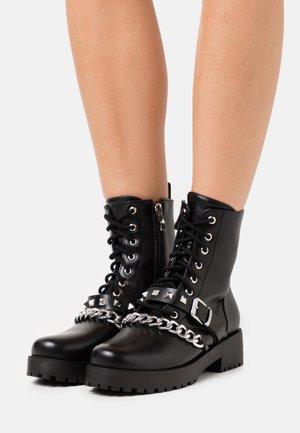 ANNIDA - Cowboy/biker ankle boot - black