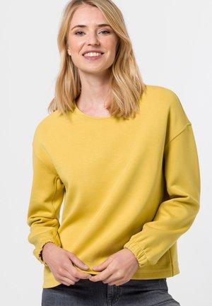 MIT TUNNELZUG - Sweatshirt - light mustard