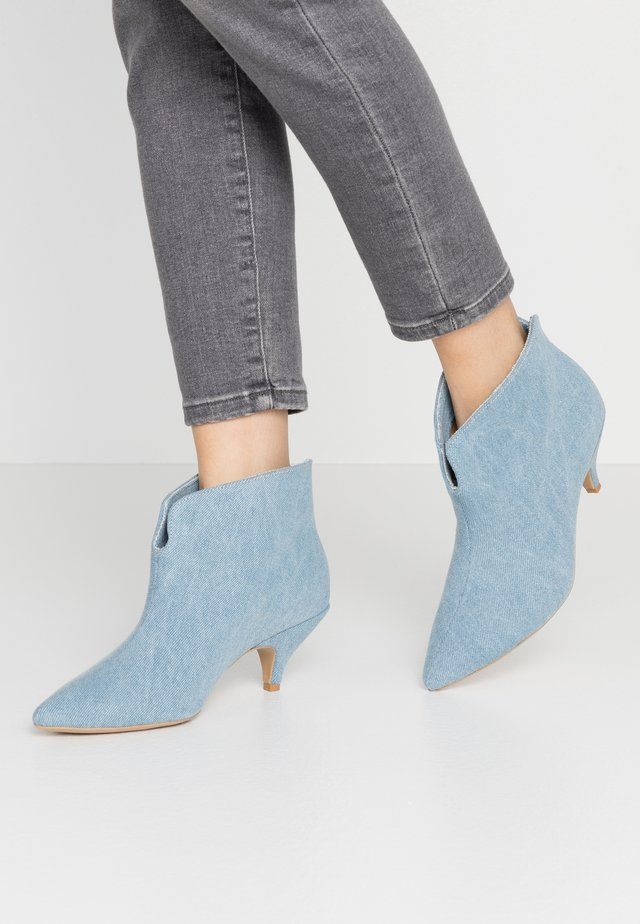 MAKE YOUR MOVE - Ankle boots - blue denim