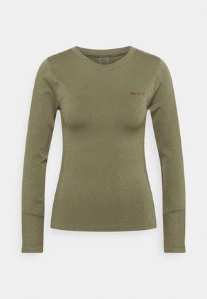 PROUD OF BEING - Sports shirt - deep lichen green