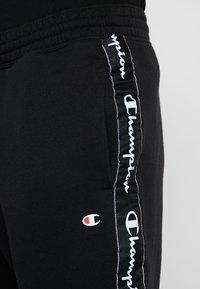 Champion - RIB CUFF PANTS - Jogginghose - black - 4