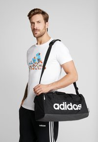 adidas Performance - ESSENTIALS LINEAR SPORT DUFFEL BAG UNISEX - Torba sportowa - black/white - 1