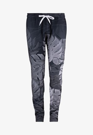 MONSTERA - Tracksuit bottoms - black