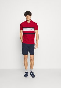 Tommy Hilfiger - CHEST STRIPE  - Polo shirt - primary red - 1