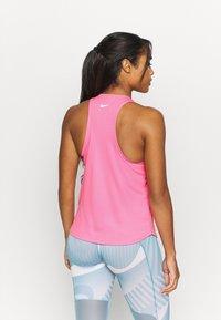 Nike Performance - RUN TANK - Camiseta de deporte - pink glow/white - 2