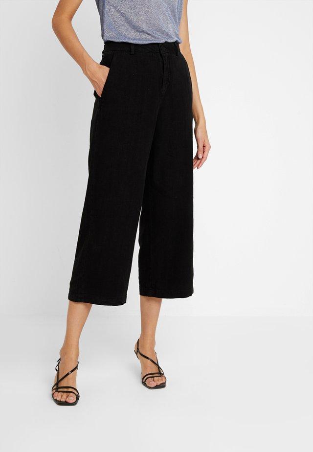 STARLIGHT - Trousers - black