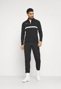 Nike Performance - DRY PANT - Spodnie treningowe - black/white - 1