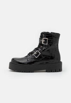 BELLA BUCKLE BOOT - Platform ankle boots - black