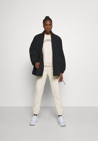 P.E Nation - DROP SHOT TRACK PANT - Tracksuit bottoms - pearled ivory - 1