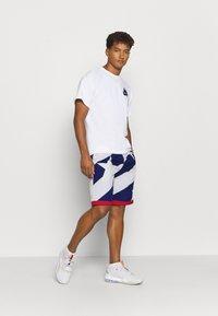 Nike Performance - THROWBACK - Sports shorts - blue void/white/university red - 1