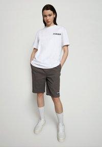 Napapijri - S JURASSIC - Print T-shirt - bright white - 0