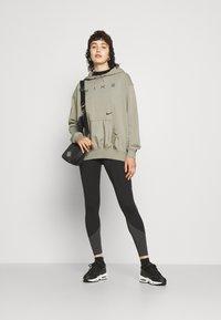 Nike Sportswear - Leggings - black/smoke grey - 4
