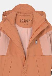Gosoaky - DESERT FOX UNISEX - Waterproof jacket - terra cotta/evening pink - 2