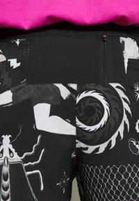 Nike Performance - WILD RUN - Sports shorts - black - 5