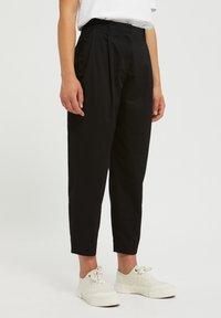 ARMEDANGELS - Trousers - black - 0