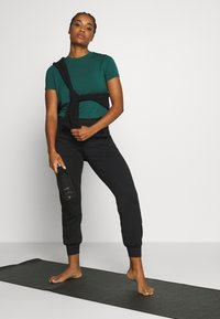 Sweaty Betty - GARY  YOGA TROUSER - Pantalones deportivos - black - 1