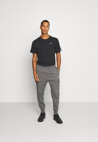 Nike Sportswear - CLUB PANT - Cargo trousers - charcoal heather/anthracite/white - 1