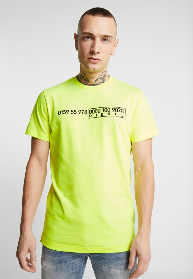 DIEGO SLITS - T-shirt con stampa - yellow