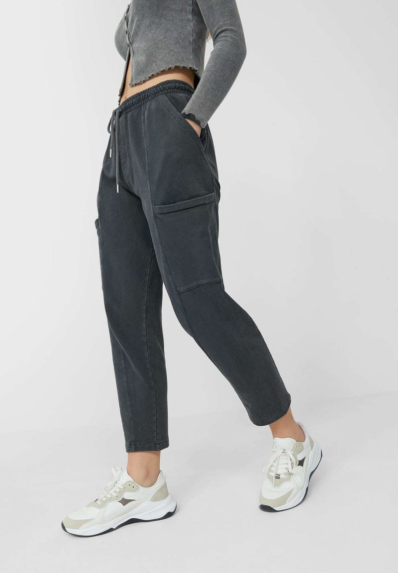 Stradivarius - IM ACID-WASH - Tracksuit bottoms - dark grey