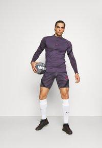 Nike Performance - Sports shirt - dark raisin/black/siren red - 1