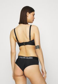 Calvin Klein Swimwear - CURVE BRAZILIAN HIPSTER - Bikini bottoms - black - 2
