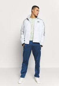adidas Originals - R.Y.V. SPORT INSPIRED TRACK TOP JACKET - Wiatrówka - offwhite - 1